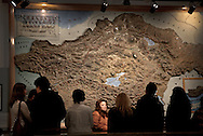 Guide in National Museum of Armenia with a group of tourists from Russia in front of historical map of Greater Armenia which marks places -today in Turkey-which used to have Armenian population.