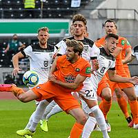12.09.2020, Donaustadion, Ulm, GER, DFB Pokal, SSV Ulm 1846 Fussball vs FC Erzgebirge Aue, <br /> DFL REGULATIONS PROHIBIT ANY USE OF PHOTOGRAPHS AS IMAGE SEQUENCES AND/OR QUASI-VIDEO, <br /> im Bild Angelo Rinaldi (Ulm, #27) stört Philipp Zulechner (Aue, #14) bereits bei der Ballannahme<br /> <br /> Foto © nordphoto / Hafner