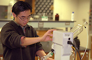 Science student age 22 working in laboratory. Macalester College St Paul  Minnesota USA