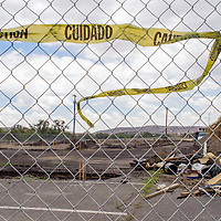 Debris and construction materials are piled to the side at the construction site for a new skate park near the Gallup Cultural Center Wednesday.