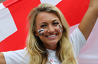 A female England fan with a painted face and flag