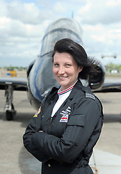 © under license to London News Pictures. DUXFORD, UK  12/05/2011. Flight Lieutenant Juliette Fleming (CR wearing dark jumpsuit) from RAF 208 Squadron joins her colleges with her Hawk aircraft.  She has seen active service in Iraq and Afghanistan and is now in her first year with the RAF display team. Female RAF personnel at The launch of the 2011 air show season at Imperial War Museum Duxford. The air show celebrates women in the development of aviation. Photo credit should read Stephen Simpson/LNP.
