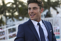 """Zac Efron talks to the press during the """"Baywatch"""" movie world premiere's beach party and red carpet event on Saturday, May 13, 2017 in Miami Beach, FL, USA. Photo by Matias J. Ocner/Miami Herald/TNS/ABACAPRESS.COM"""