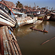 Teenagers eke out a living by fishing in Nagappattinam, in the southeastern coast of India, after their families' boats were smashed by the tsunami. .The December 26, 2004 tsunami killed thousands of people along this coast, smashing boats, roads and houses and tearing thousands of families apart. .Picture taken February 2005 in Nagapptinam, Tamil Nadu, India, by Justin Jin.