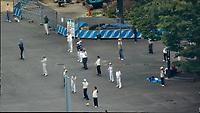 Early Morning Strech and Exercise at Niagara Falls in Shinjuku Chuo Park in Tokyo. Composite of 7 mages taken with a Nikon 1 V3 camera and 70-300 mm VR lens from my hotel room on the 20th floor in the Keio Plaza hotel (aprox. 400 meters distance).<br /> Photoshop, Statistics, Median.