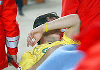 23/11/2004 - UEFA Champions League - Group A - AS Monaco v Liverpool  - Stade Louis II, Monte Carlo<br />Liverpool's Luis Garcia shields his face as he is carried off injured on a stretcher after breaking down within the first minute<br />Photo:Jed Leicester/Back Page Images