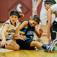 Ramah Mustang Kourtney Lewis (11), left, scrambles for a ball after it bounces from Navajo Prep Eagle Martinique Larvingo (11) at Ramah High School Tuesday.