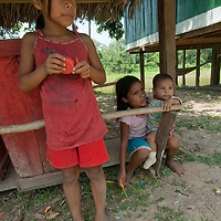 Yanayacu Indian children rest outside their family's hut in San Juan de Yanayacu village in Peru's Amazon Jungle.