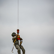 A US Army Flight Medic rides the rescue seat.