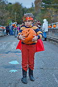 Fall Boy.  A boy and his jack o' lantern on the old Bynum Bridge in Bynum, NC during the annual Bynum Pumpkins on the Bridge celebration.