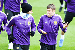 Martin Demichelis & James Milner of Manchester City pictured during the training session at The Etihad Campus ahead of the UEFA Champions League clash with FC Barcelona - Photo mandatory by-line: Matt McNulty/JMP - Mobile: 07966 386802 - 23/02/2015 - SPORT - Football - Manchester - Etihad Stadium