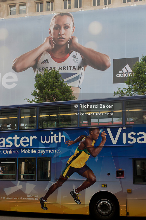 Jamaican sprinter Usain Bolt's Visa ad on a red London bus and a inspiring image of Team GB gold medallist heptathlete Jessica Ennis on the exterior of the Adidas store in central London's Oxford Street, during the London 2012 Olympic Games. The Ennis ad is for sports footwear brand Adidas and their 'Take The Stage' campaign which is viewable across Britain and to Britons who have been cheering these athletes who have been winning medals in numbers not seen for 100 years. Their heroic performances have surprised a host nation who until the victories, were largely anti-Olympics - now adoring their darling Ennis and her good looks.