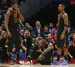 April 29, 2018 - Cleveland, OH, USA - Cleveland Cavaliers forward LeBron James holds his head alongside teammate Tristan Thompson and J.R. Smith after a technical foul from Indiana Pacers' Lance Stephenson in the first quarter of Game 7 of the Eastern Conference First Round series on Sunday, April 29, 2018 at Quicken Loans Arena in Cleveland, Ohio. The Cavs won the game, 105-101. (Credit Image: © Leah Klafczynski/TNS via ZUMA Wire)