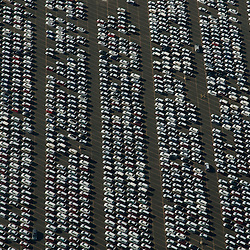 Aerial view of new cars lined up at the port of new york