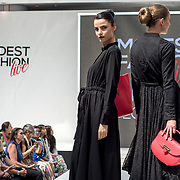 Aspinal of London showcases it latest collection Modest and beautiful at the Modest and Beautiful a Modest Fashion Live at The Atrium in Westfield London on June 24, 2018.