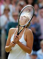 WIMBLEDON CHAMPIONSHIPS 01/07/04 DAY 10<br />MARIA SHARAPOVA (RUS) CELEBRATES WINNING SEMI FINAL MATCH<br />Photo Roger Parker Fotosports International