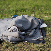 A man sleeps in a field near Idomeni,Greece. <br /> <br /> Thousands of refugees are stranded in Idomeni unable to cross the border. The facilities are stretched to the limit and the conditions are appalling.