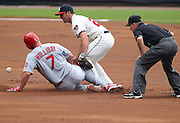 ATLANTA, GA - JULY 27:  Left fielder Matt Holliday #7 of the St. Louis Cardinals slides in to second base while second baseman Dan Uggla #26 of the Atlanta Braves chases the ball and second base umpire Jerry Meals #41 looks on during the game at Turner Field on July 27, 2013 in Atlanta, Georgia.  (Photo by Mike Zarrilli/Getty Images)