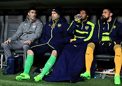 Arsenal goalkeeper Petr Cech (centre), Arsenal's Mohamed Elneny (second right) and Arsenal's Olivier Giroud (right) in the dugout