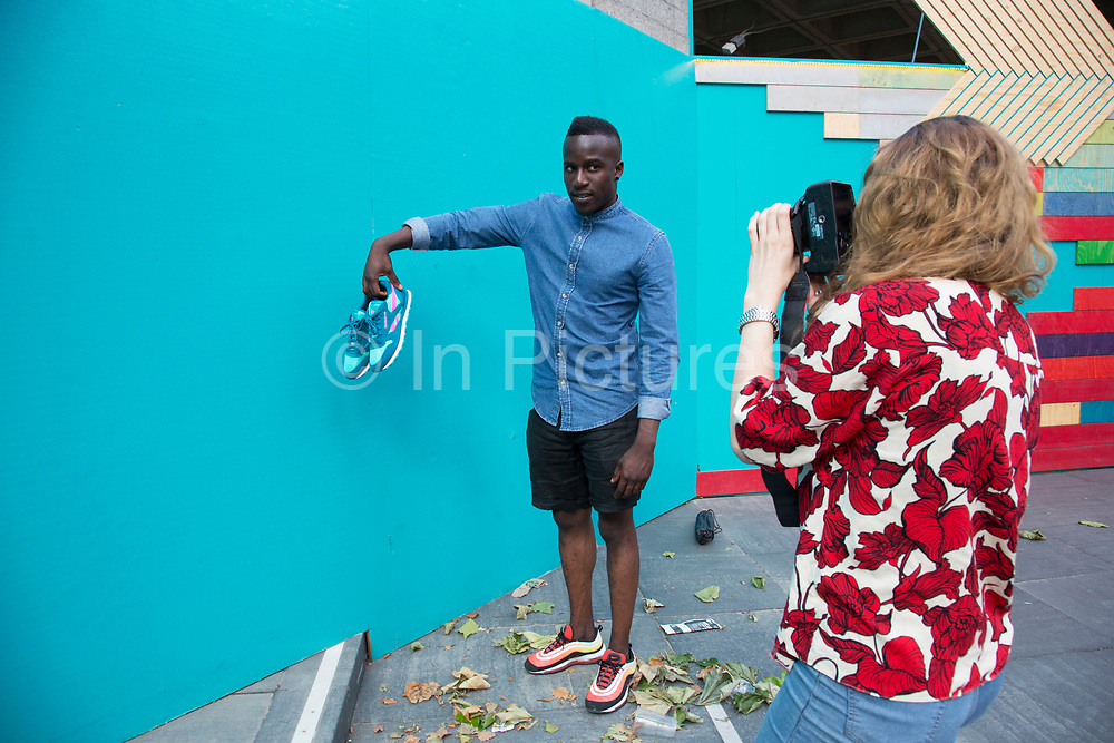 Fashion company Restock on a trainers photo shoot. The South Bank is a significant arts and entertainment district, and home to an endless list of activities for Londoners, visitors and tourists alike.