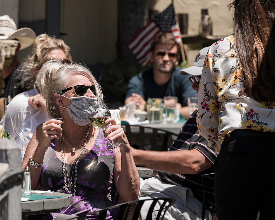 Customers eat and drink at The Tuck Box restaurant in Carmel, Calif. continued to defy orders from the Monterey County Health Department to stop dine-service on May 15, 2020, a day after District Attorney Jeannine Pacioni announced criminal charges warned owner Jeffrey LeTowt about. Charges include three misdemeanor counts of violating the shelter-in-place order, each of which comes with the possibility of a $1,000 fine and/or six months imprisonment.