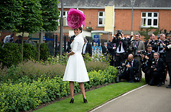 © London News Pictures. 18/06/2013. Ascot, UK.  A woman in an elaborate hat poses for photographers on day one of Royal Ascot at Ascot racecourse in Berkshire, on June 18, 2013.  The 5 day showcase event,  which is one of the highlights of the racing calendar, has been held at the famous Berkshire course since 1711 and tradition is a hallmark of the meeting. Top hats and tails remain compulsory in parts of the course. Photo credit should read: Ben Cawthra/LNP