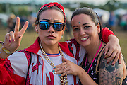 A couple (pictured) who have just got engaged celebrate with their friends - The 2016 Glastonbury Festival, Worthy Farm, Glastonbury.