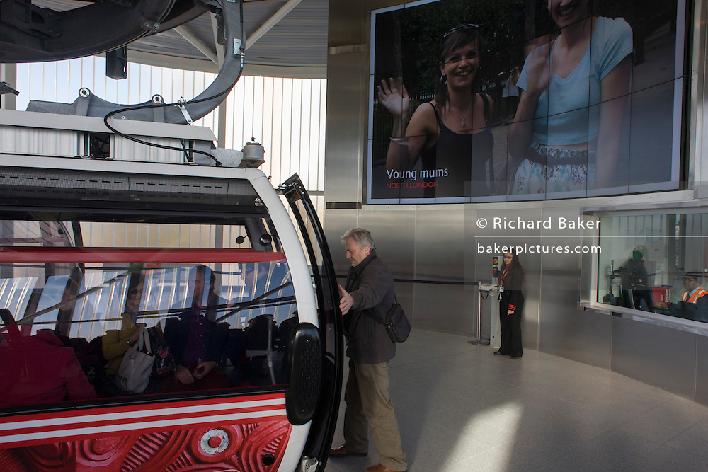 Passengers board the (Emirates) Thames Cable Car at the nothern Royal Docks terminus. There are 34 gondolas, each with a maximum capacity of 10 passengers. The Emirates Air Line (also known as the Thames cable car) is a cable car link across the River Thames in London built with sponsorship from the airline Emirates. The service opened on 28 June 2012 and is operated by Transport for London. The service, announced in July 2010 and estimated to cost £60 million, comprises a 1-kilometre (0.62 mi) gondola line that crosses the Thames from the Greenwich Peninsula to the Royal Docks. ..
