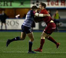 Munster's Darren Sweetnam vies with Cardiff Blues' Garyn Smith for the ball<br /> <br /> Photographer Simon King/Replay Images<br /> <br /> Guinness PRO14 Round 15 - Cardiff Blues v Munster - Saturday 17th February 2018 - Cardiff Arms Park - Cardiff<br /> <br /> World Copyright © Replay Images . All rights reserved. info@replayimages.co.uk - http://replayimages.co.uk