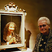 """VENICE, ITALY - MARCH 09:  Stylist Mariuccia Missoni poses for a picture next to a 17 Century wax portrait during  the press preview of """"Avere Una Bella Cera - Wax Portraits Exhibition"""" at Palazzo Fortuny on March 9, 2012 in Venice, Italy.  The exhibition open until June 25 is the world's first exhibition on wax portraits analizing a field that has been studied very little by art historians."""
