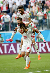 SAINT PETERSBURG, June 15, 2018  Iran's Sardar Azmoun (bottom), Alireza Jahanbakhsh (C) and Ramin Rezaeian celebrate their victory after a group B match between Morocco and Iran at the 2018 FIFA World Cup in Saint Petersburg, Russia, June 15, 2018. Iran won 1-0. (Credit Image: © Li Ming/Xinhua via ZUMA Wire)