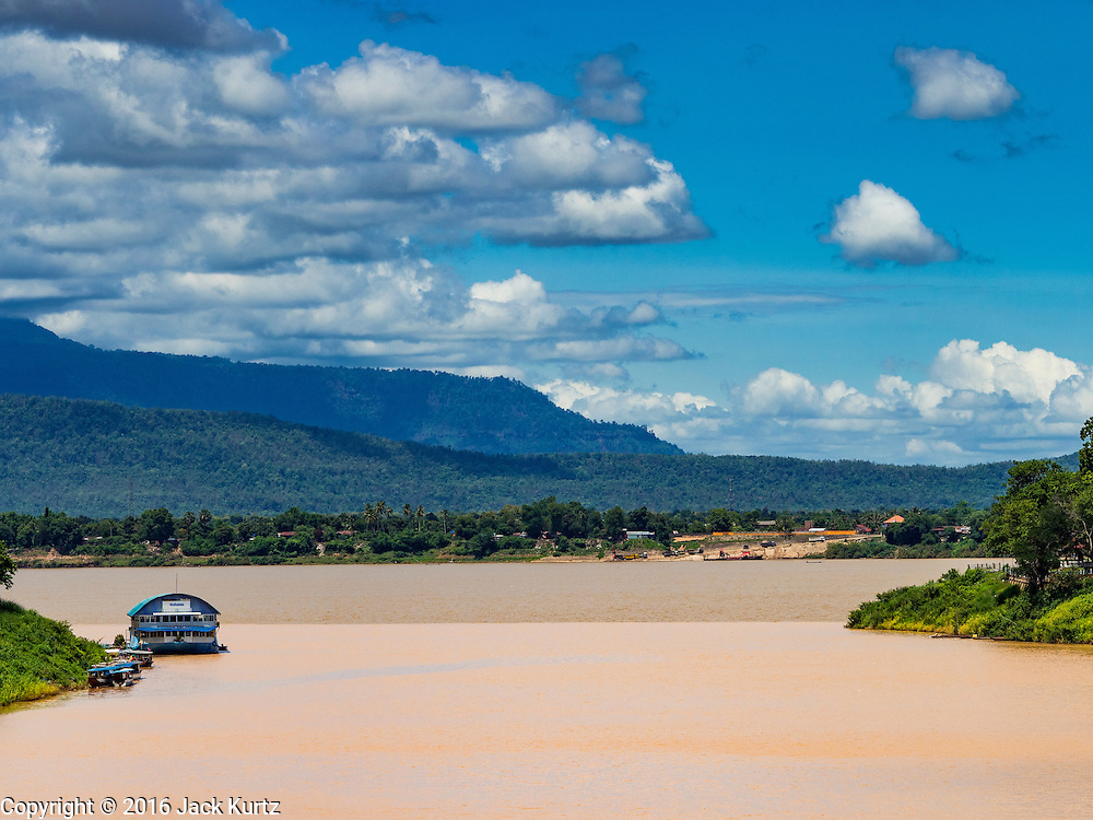 16 JUNE 2016 - PAKSE, CHAMPASAK, LAOS: The Xe Don River, where it flows into the Mekong River in Pakse. The Mekong is the darker brown in the far background. Pakse is the capital of Champasak province in southern Laos. It sits at the confluence of the Xe Don and Mekong Rivers. It's the gateway city to 4,000 Islands, near the border of Cambodia and the coffee growing highlands of southern Laos.      PHOTO BY JACK KURTZ