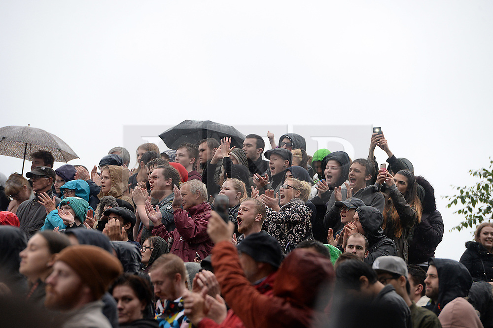 © Licensed to London News Pictures. 05/06/2017. Newcastle Upon Tyne, UK.  Supporters cheer as Jeremy Corbyn MP, Leader of the Labour Party, addresses the crowd of hundreds of his supporters who waited in the rain to hear him speak outside the Sage in Gateshead. Mr Corbyn spent one of the final days of the campaign trail in the Labour heartlands of North-East England before voters go to the polls in the UK General Election on June 8th 2017. Photo credit: MARY TURNER/LNP
