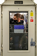 A passengers wearing face surgical masks to curb the spread of Coronavirus is preparing to leave the Jubilee Line train (eastbound) in Westminster station, central London on Wednesday, Oct 14, 2020. The UK has recorded 12,872 more coronavirus cases and 65 deaths in the latest daily government update. It marks a slight fall from last Saturday when 15,166 cases and 81 deaths were recorded. The UK's coronavirus death toll now stands at 42,825. (VXP Photo/ Vudi Xhymshiti)