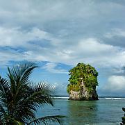 Seastack in the protected bay of Pago Pago, Tutuila Island, American Samoa.