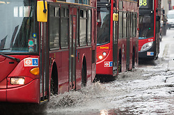 © licensed to London News Pictures. London, UK 11/06/2012. Buses splashing water from puddles in Regent Street, today (11/06/12). Photo credit: Tolga Akmen/LNP