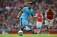 Manchester City's David Silva passing the ball. Barclays Premier league match, Arsenal v Manchester city at the Emirates Stadium in London on Saturday 13th Sept 2014.<br /> pic by John Patrick Fletcher, Andrew Orchard sports photography.