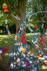 © Licensed to London News Pictures. 04/08/2021. Kilsby, Northamptonshire, UK. The ladies of the Kilsby WI have Yarn-Bombed their small village to celebrate its centenary. The main feature, a knitted a court room scene which sits outside the village hall to mark the Centenary of the village. The work celebrates women on Jury service and is complete with jury, defendant and Judge. The group have also installed other displays around the village including displays on Keep Britain Tidy, Midwives, plastic Pollution and honeybees. Photo credit: Dave Warren / LNP