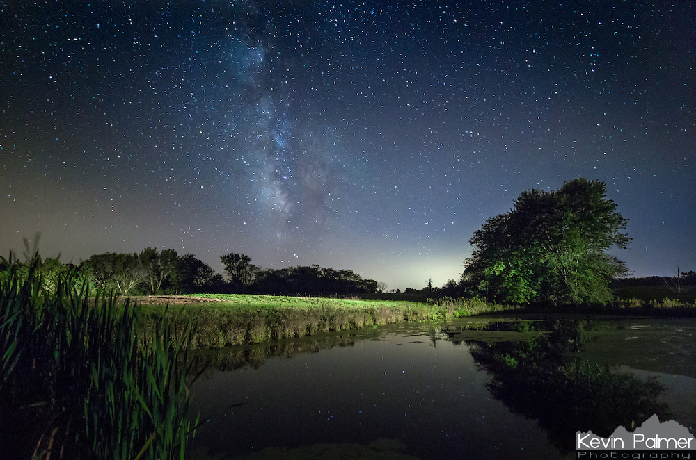 The milky way shines above a small pond in Weinberg King State Park. I took 300 pictures here for a time lapse. In a few of the frames, I pointed my car headlights at the pond from 100 yards away. When the headlights were on for the full 30 second exposure it was too bright. But when the headlights were only on a part of the time it was just right.