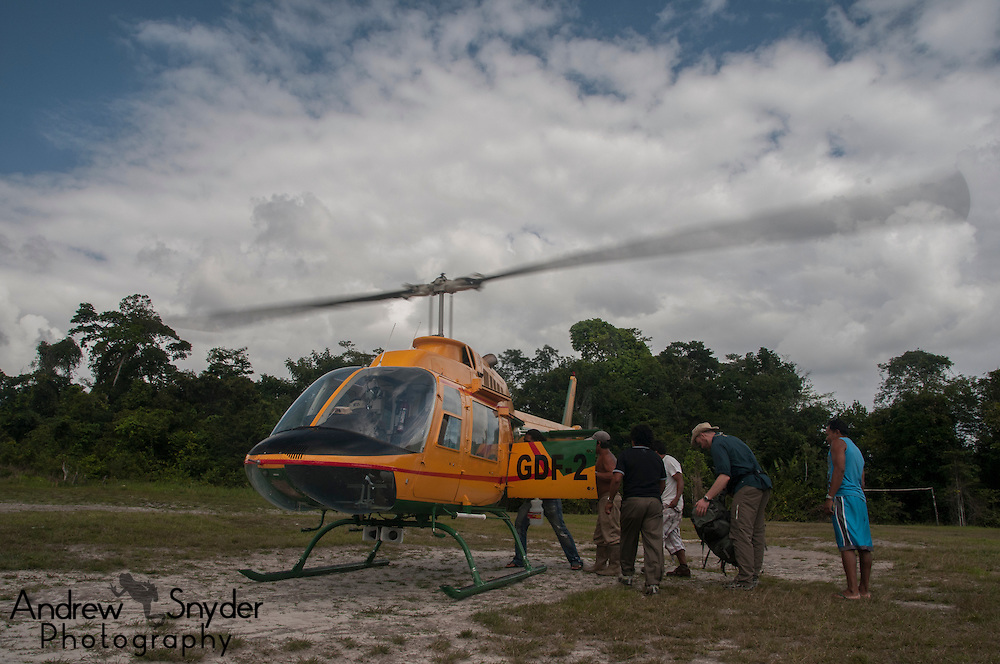 Our helicopter about to depart from Chenapau Village.