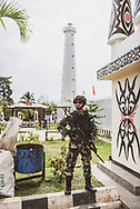 Papua, Indonesia - July 17, 2017: An Indonesian soldier stands guard at the Skouw border post, located just outside Jayapura, Papua, Indonesia. This is the only land border crossing between Indonesia and Papua New Guinea.