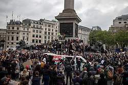 © Licensed to London News Pictures. 12/06/2020. London, UK. People gather around Nelson's Column in Trafalgar Square during a Black Lives Matter protest in London. Protests have taken place across the United States and in cities around the world in response to the killing of George Floyd by police officers in Minneapolis on 25 May. Photo credit: Rob Pinney/LNP