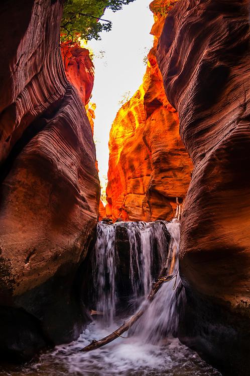 Hiking in a slot canyon en route to Kanarra Creek Falls, near Cedar City, Utah USA