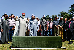 JOHANNESBURG, March 29, 2017  Muslim communities prepare to pray for Ahmed Kathrada in front of his coffin during his funeral at Westpark Cemetery in Johannesburg, South Africa, on March 29, 2017. South African anti-apartheid stalwart Ahmed Kathrada died in the early hours of Tuesday morning at the age of 87.  sxk) (Credit Image: © Zhai Jianlan/Xinhua via ZUMA Wire)