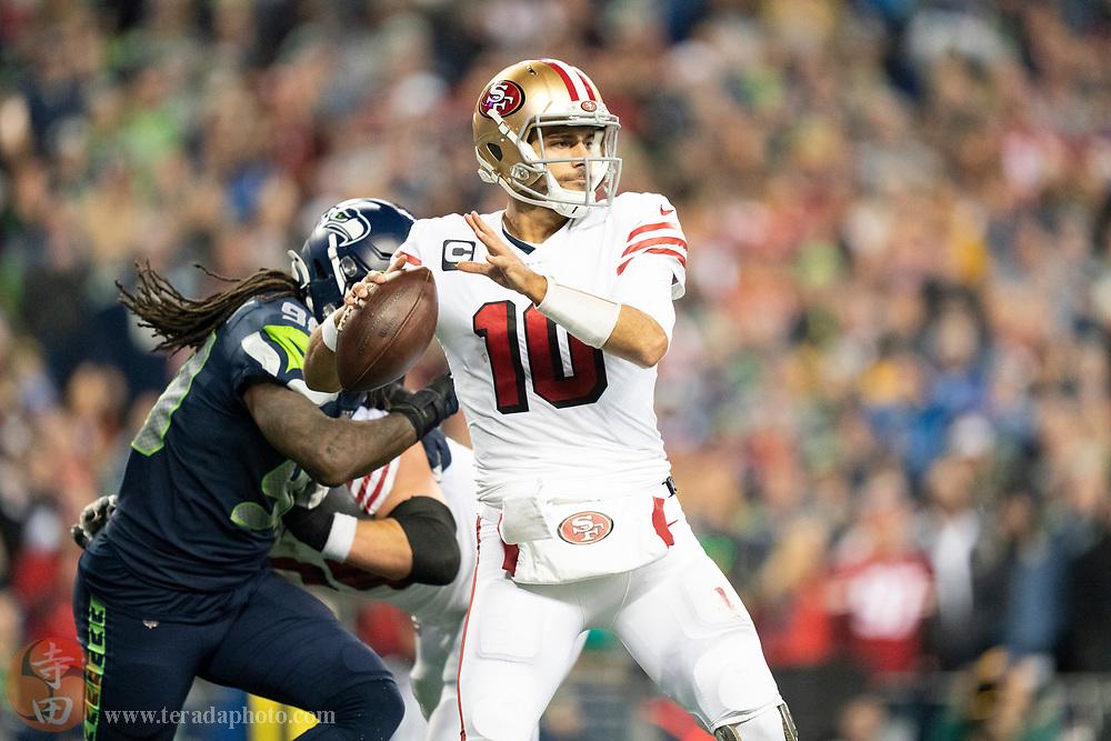 December 29, 2019; Seattle, Washington, USA; San Francisco 49ers quarterback Jimmy Garoppolo (10) during the fourth quarter against the Seattle Seahawks at CenturyLink Field.