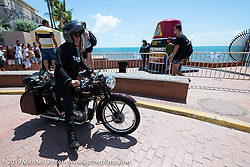 Keith Martin stopped with his 1938 Triumph 500 cc Speed Twin at the southernmost point buoy marker at the end of the Cross Country Chase motorcycle endurance run from Sault Sainte Marie, MI to Key West, FL. (for vintage bikes from 1930-1948). Riding through town just before at the end of the 110 mile Stage-10 ride from Miami to Key West, FL USA. Sunday, September 15, 2019. Photography ©2019 Michael Lichter.