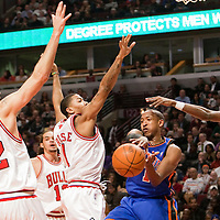 17 December 2009: New York Knicks Chris Duhon passes the ball as Chicago Bull Brad Miller, Derrick Rose and John Salmon defend during the Chicago Bulls 98-89 victory over the New York Knicks at the United Center, in Chicago, Illinois, USA.