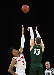 November 14, 2017 - Oxford, Ohio, U.S - Miami (Oh) Redhawks guard Jalen Adaway (3) trys to block the shot of Wright State Raiders guard Grant Benzinger (13). During play on the Miami (Oh) Redhawks campus in Oxford. As the Miami (Oh) Redhawks win over Wright State Raiders on Tue Nov 14, 2017 in Over time 73 to 67. (Credit Image: © Ernest Coleman via ZUMA Wire)