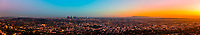 Panoramic view of Los Angeles at sunset, with Downtown L.A. to the left and the Pacific Ocean on the right. Los Angeles, California USA.