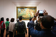 Tourists in the Ufizzi Gallery take photos of Sandro Botticelli's Birth of Venus painting in Florence, Tuscany, Italy.<br /> Picture date: Sunday February 24, 2019.<br /> Photograph by Christopher Ison ©<br /> 07544044177<br /> chris@christopherison.com<br /> www.christopherison.com